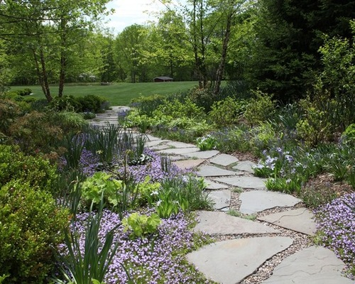 What To Know About Installing A Walkway Of Pavers And Pebbles